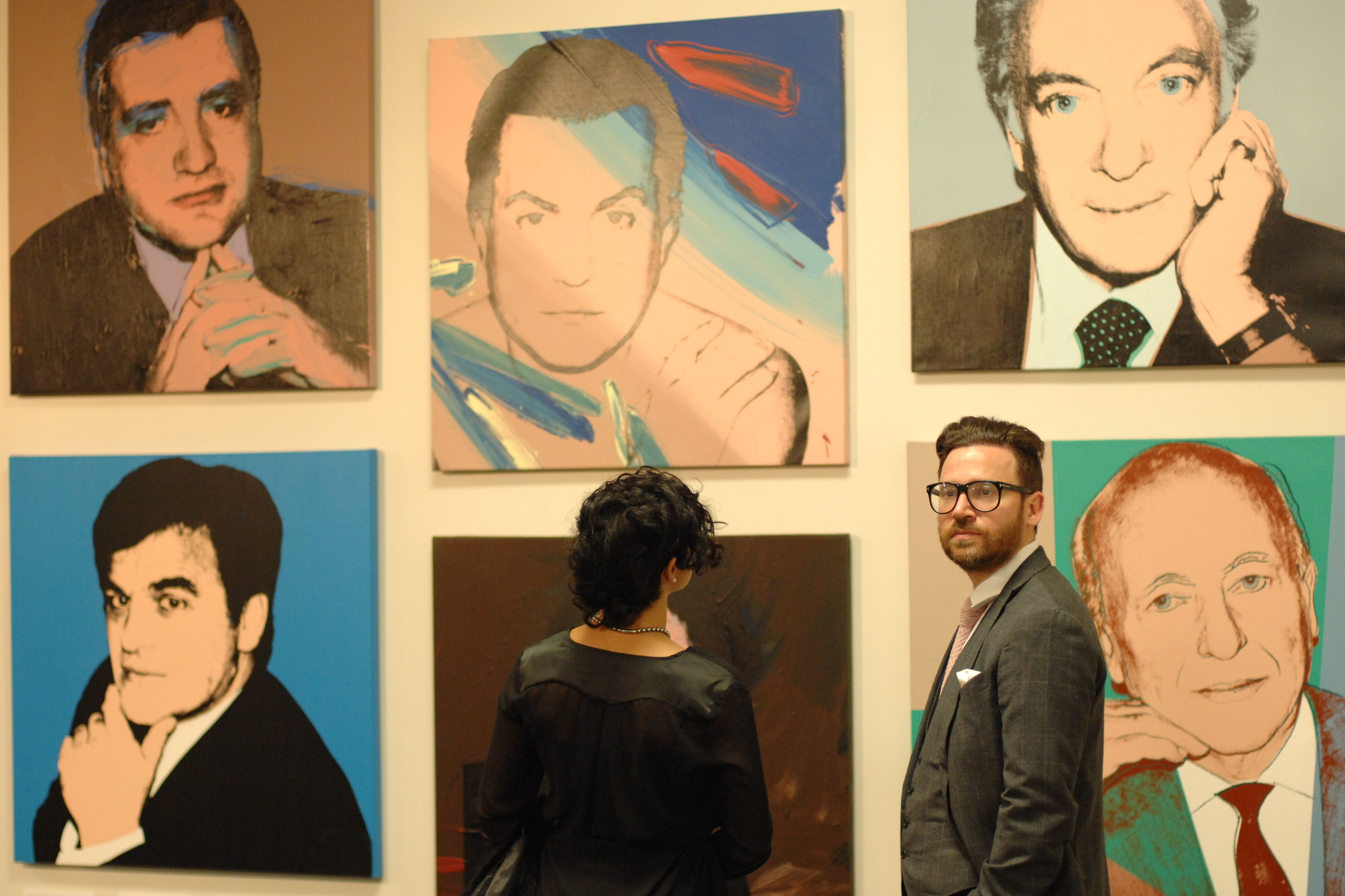 wall of portrait paintings