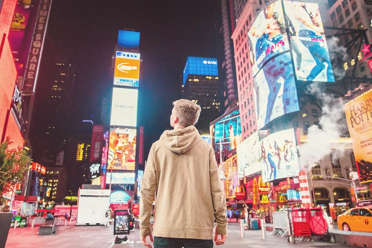 boy looking at the lights in Time Square