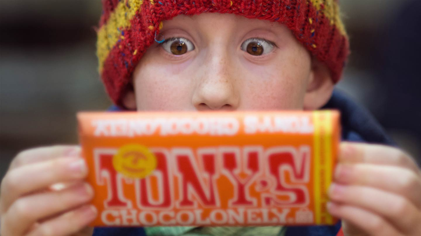 boy reading the back of a chocolate bar