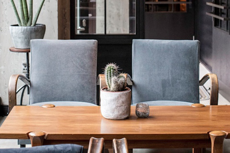 four chairs and a table with a potted cactus