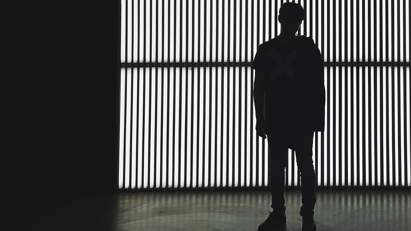 man standing in front of vertical blinds